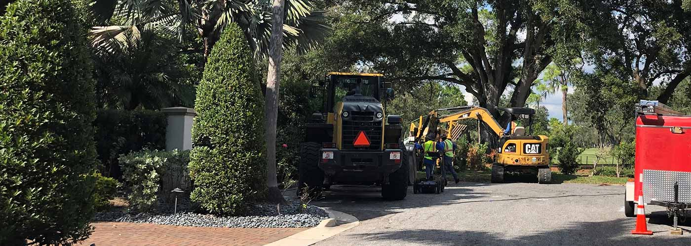 Construction workers and equipment working on a FY19 WMI segement